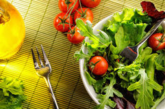 Salad in a bowl on bamboo tablecloth top view Royalty Free Stock Photography