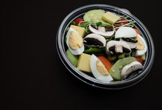 Salad bowl on black background Stock Images