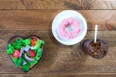 Salad in a bowl made of heart-shaped wood. stock photos