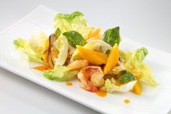 Salad. A bowl of salad with prawn and mango Stock Image