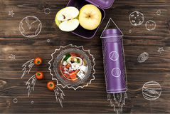 Salad bowl standing on the table near thermos Royalty Free Stock Photo