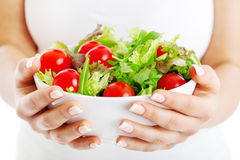 Salad bowl in woman hands Royalty Free Stock Image