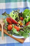 Salad Bowl on Wooden Board Stock Photo