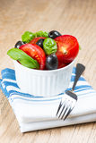 Salad in bowl on wooden table Royalty Free Stock Photography