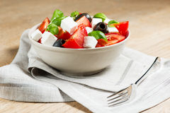 Salad in bowl on wooden table Stock Photo
