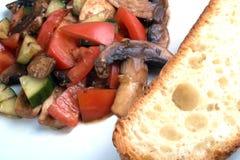 Salad and bread. Tomato salad with slice of ciabatta bread Stock Photo