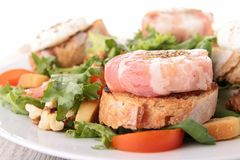 Salad, bread and cheese with bacon Royalty Free Stock Photo