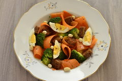 Salad with broccoli, carrots, egg and rye croutons Stock Images