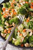 Salad with broccoli, carrots and peanuts closeup vertical top vi Stock Photos