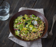 Salad from brussels sprouts with radish, raisins and sprouts of wheat Stock Image
