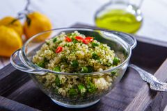 Salad with bulgur and green peas in a glass bowl royalty free stock photography
