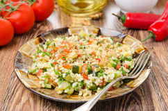 Salad with bulgur, zucchini, tomatoes and parsley Stock Photography