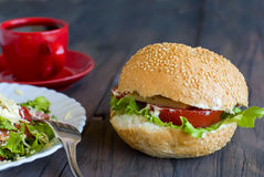Salad, a burger and a cup of coffee for breakfast Stock Photography