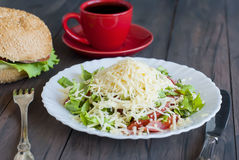 Salad, a burger and a cup of coffee for breakfast Stock Photo