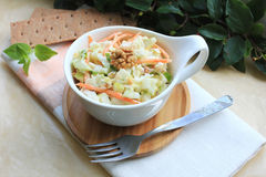 Salad with cabbage, carrot, apples and pears with walnuts Stock Image