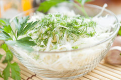 Salad from cabbage and dill in a transparent bowl Royalty Free Stock Image