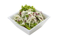 Salad with cabbage, ham and greens. stock photo