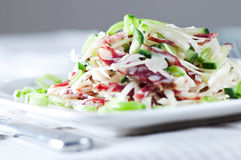 Salad with cabbage , sausage, cucumber and green peas close up Stock Images