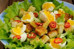 Salad Caesar with eggs, chili pepper closeup macro Royalty Free Stock Photography