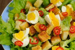 Salad Caesar with eggs, chili pepper closeup macro Royalty Free Stock Photos