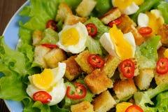 Salad Caesar with eggs, chili pepper closeup macro Royalty Free Stock Photos