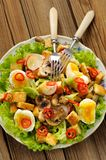 Salad Caesar with mushrooms, eggs, chili and radish Royalty Free Stock Photography