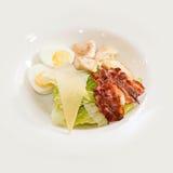 Salad Caesar. Tasty summer salad Caesar salad with egg and fried bacon Stock Image