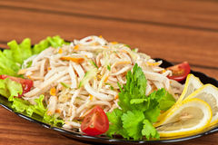 Salad with calamary. And fresh vegetable Stock Image