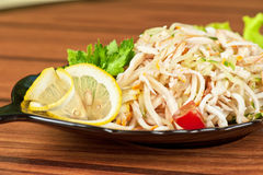 Salad with calamary. And fresh vegetable Royalty Free Stock Image