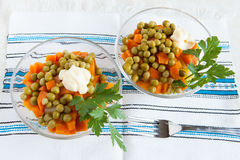 Salad with canned peas and boiled carrots Royalty Free Stock Image