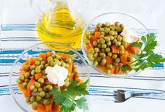 Salad with canned peas, boiled carrots and oil Stock Images