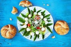 Salad caprese on blue background Stock Photography