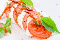 Caprese salad or Buffalo mozzarella with tomatoes Stock Photos