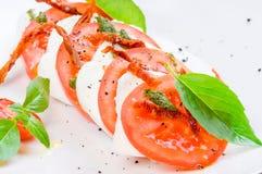 Caprese salad or Buffalo mozzarella with tomatoes stock photos
