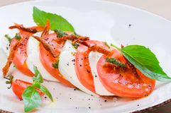 Caprese salad or Buffalo mozzarella with tomatoes Stock Images