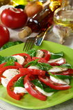 Salad caprese with tomatoes, cheese and basil. Stock Photo