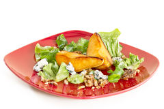 Salad with caramelised pears,walnuts and blue cheese, on red Royalty Free Stock Photography