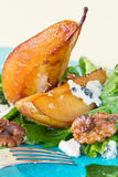 Salad with caramelised pears, walnuts and blue cheese, vertical Stock Photo