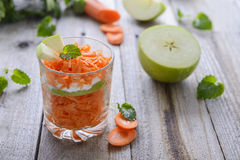 Salad from carrot, apples and yoghurt. Stock Photos