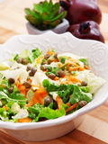 Salad with carrots, arugula and capers Stock Images