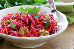 Salad with carrots, beetroot, apple Stock Photo