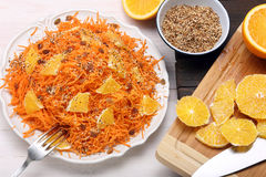 Salad from carrots with orange, raisins and roasted sesame seeds Stock Images