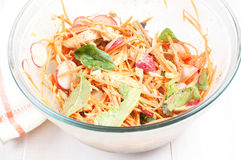 Salad with carrots, radishes and chicken Royalty Free Stock Image