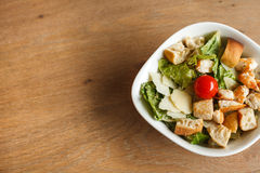 Salad ceasar. On wooden table Royalty Free Stock Image