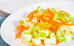Salad with celery, carrots and apples Royalty Free Stock Photography