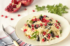 Salad with celery root, olives and pomegranate Stock Image