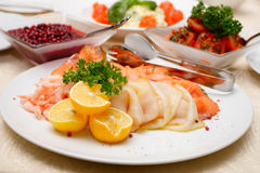 Salad on ceramic dish. Salad with lemons, shrimps, trout, salmon and parsley Stock Photography