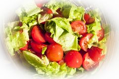 Salad with cheery tomatoes and green leaves Royalty Free Stock Photo