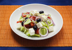 Salad With Cheese. Colorful and fresh salad with cheese in white plate Stock Image