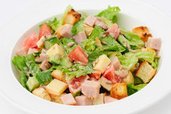 Salad with cheese, ham and fresh vegetables Royalty Free Stock Image